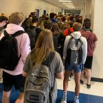 The Georgia school that punished students for posting photos of a packed hallway says it will close for 2 days after multiple students and staff got COVID-19
