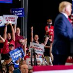 Trump says he's 'not at all concerned' about contracting the coronavirus at his rallies because he stands 'very far away' from his maskless supporters