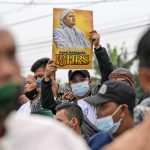 Indonesian cleric gets 4 years for concealing COVID-19 test