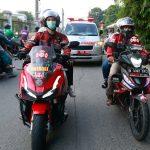 Indonesian bikers brave COVID-19 surge to escort ambulances