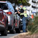 Australia to lift 18-month COVID-19 travel ban in Nov.